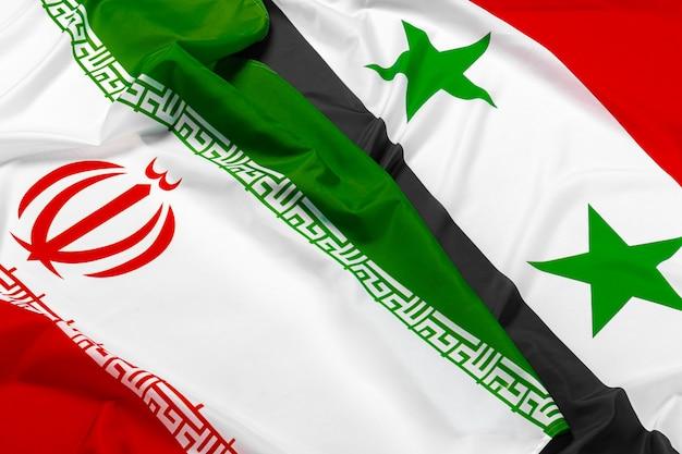 Flaga syrii i iranu na białym tle