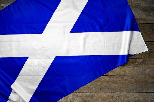 Flaga szkocji na drewniane tła grunge