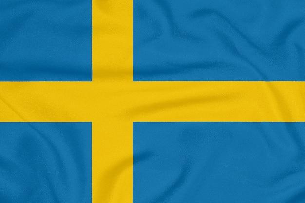 Flaga szwecji na teksturowanej tkaninie.
