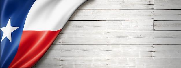 Flaga teksasu na białej ścianie z drewna, usa. ilustracja 3d