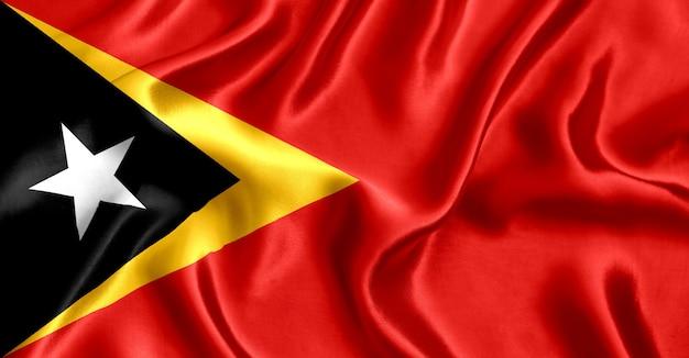 Flaga timoru wschodniego jedwabiu szczegół tło