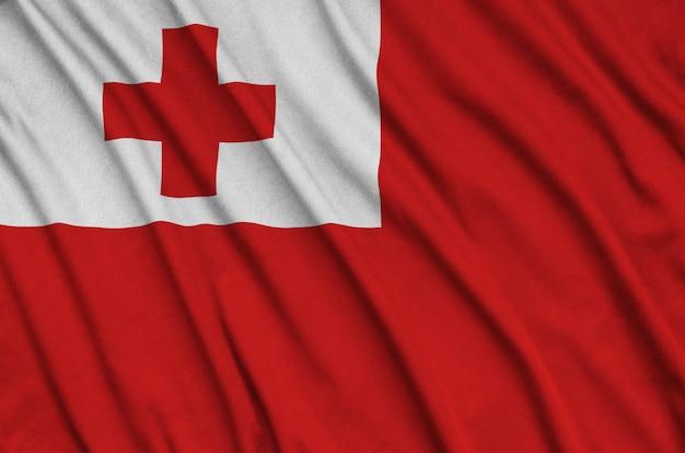Flaga tonga jest przedstawiona na tkaninie sportowej z wieloma zakładkami.