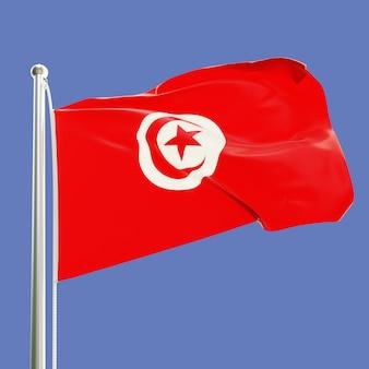 Flaga tunezji na maszcie machającym na wietrze na tle błękitnego nieba