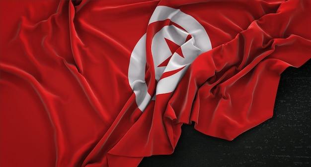 Flaga tunezji zgnieciony na ciemnym tle renderowania 3d