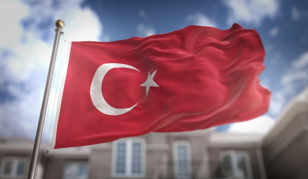 Flaga turcja 3d renderowania na tle błękitne niebo budynku