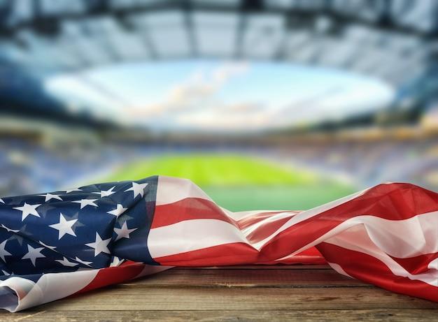 Flaga usa na stadionie w tle