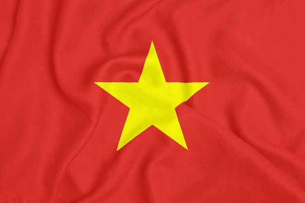 Flaga wietnamu na teksturowanej tkaninie. symbol patriotyczny