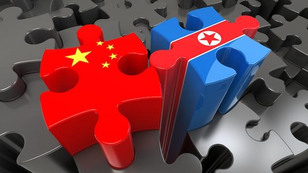 Flagi chin i korei północnej na puzzlach. koncepcja relacji politycznych. renderowanie 3d