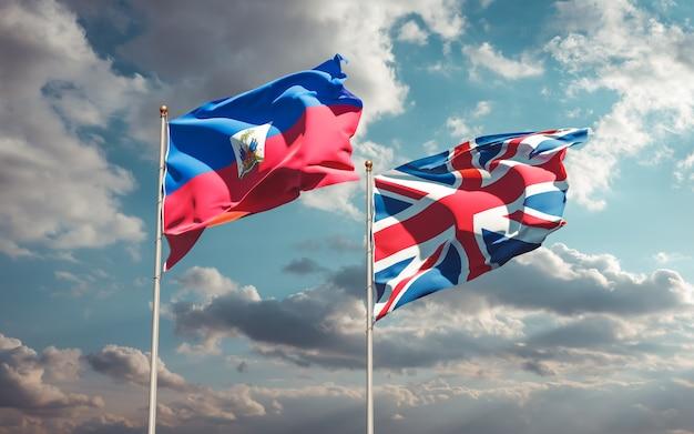Flagi haiti i wielkiej brytanii na błękitne niebo. grafika 3d