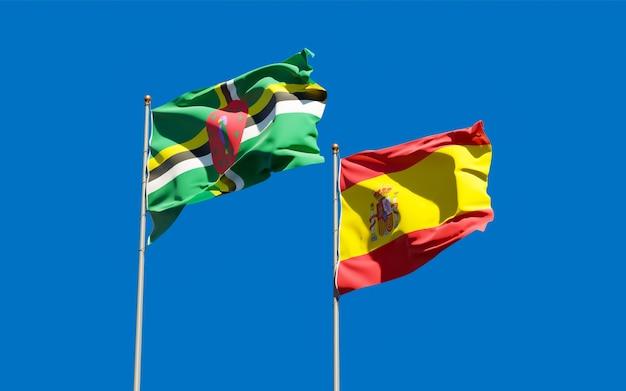 Flagi hiszpanii i dominiki.