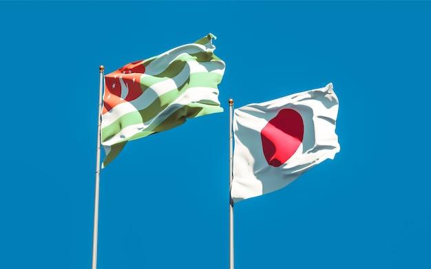 Flagi japonii i abchazji. grafika 3d