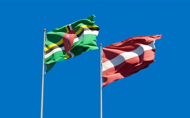 Flagi łotwy i dominiki.