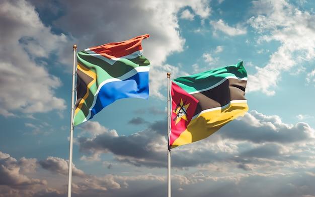 Flagi mozambiku i sar afryki na błękitne niebo. grafika 3d
