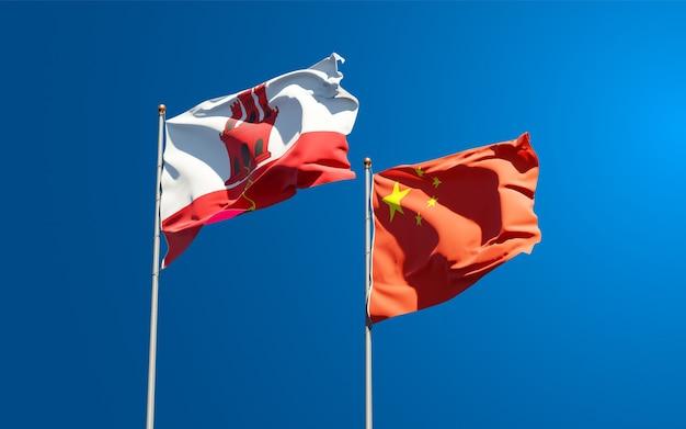Flagi państwowe gibraltaru i chin razem