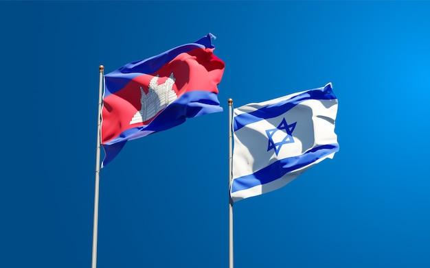 Flagi państwowe izraela i kambodży razem na tle nieba