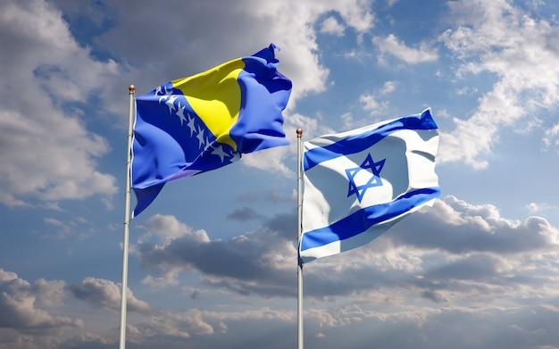 Flagi państwowe izraela oraz bośni i hercegowiny razem na tle nieba