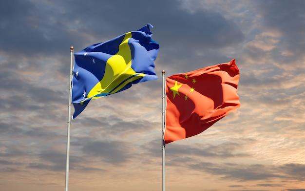 Flagi państwowe tokelau i chin razem