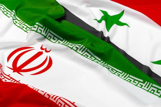 Flagi syrii i iranu razem z bliska