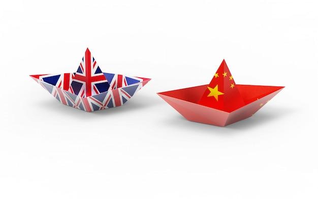 Flagi wielkiej brytanii i chin na papierowej łodzi.