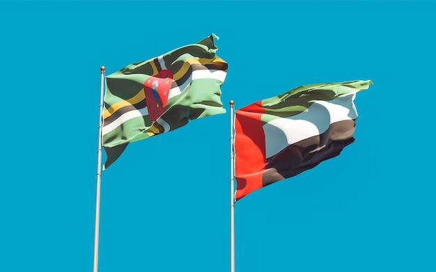 Flagi zjednoczonych emiratów arabskich i dominiki. grafika 3d