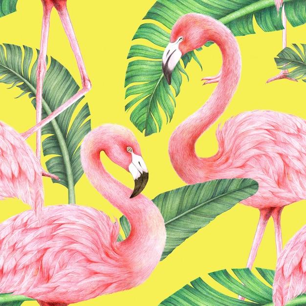 Flamingi i liście bananowca na żółtym tle