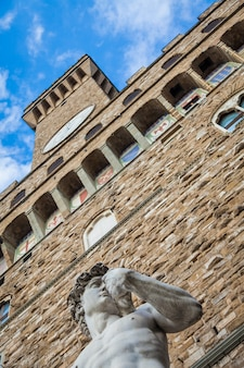 Florencja, włochy. dawid michała anioła przed palazzo vecchio.