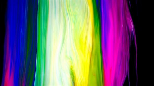 Fluid liquide art akrylowe farby olejne tekstury. abstrakcyjny efekt mieszania farby tła. płynna, kolorowa grafika akrylowa spływa plamami. fluid art tekstury przepełnione kolorami