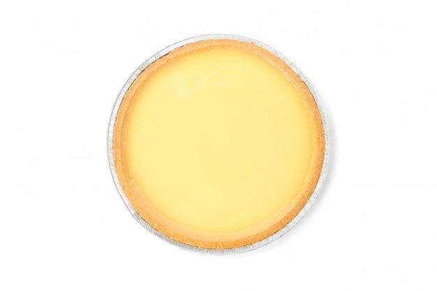 Foliowy talerz z wyśmienicie cytrynowym tarta odizolowywającym na bielu