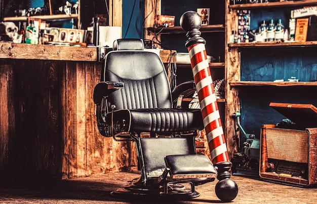 Fotel fryzjerski, salon, salon fryzjerski dla mężczyzn. słup fryzjerski. logo zakładu fryzjerskiego, symbol.
