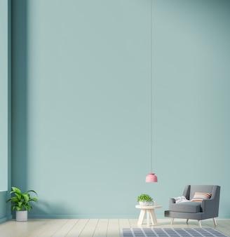 Fotel i roślin na pustej zielonej ścianie.