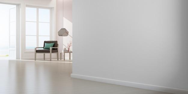 Fotel na drewnianej podłodze z oknem i różową betonową ścianą w dużym salonie w nowoczesnym nowym domu.