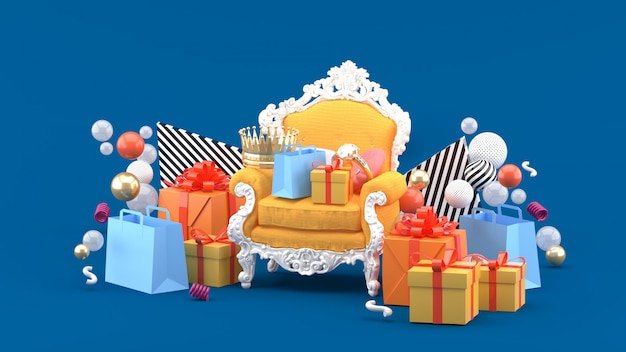 Fotele, korony, pierścionki i prezenty pośród kolorowych kulek na niebiesko. renderowania 3d.