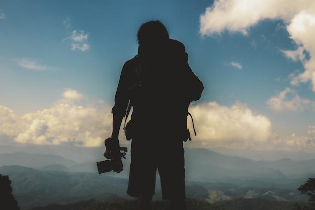Fotograf o zachodzie słońca.