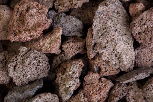Fotografia makro kamieni czerwonej lawy wulkanicznej. zdjęcie w wysokiej rozdzielczości.