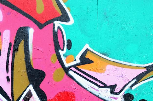 Fragment pięknego wzoru graffiti w kolorze różowym i zielonym z czarnym konturem. tło sztuki ulicznej