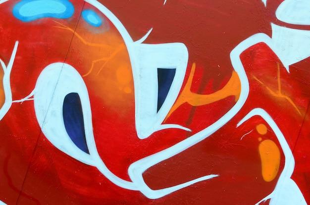 Fragment rysunków graffiti.