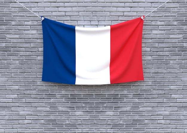 Francja flaga wiesza na ściana z cegieł