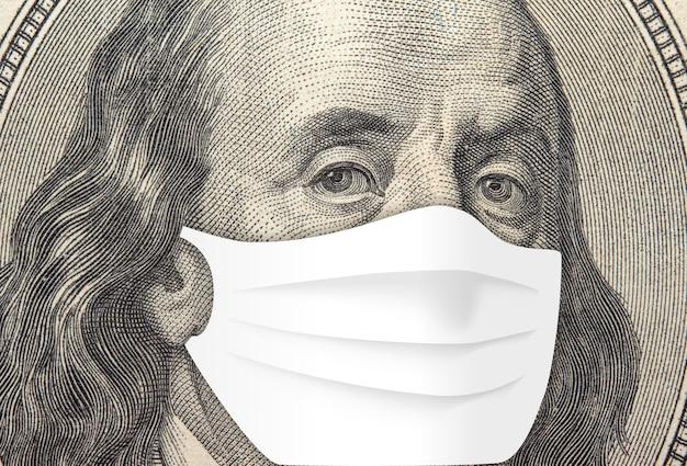 Franklin na banknocie stu dolarowym. koncepcja pandemii koronawirusa