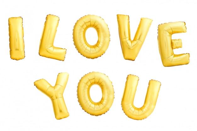 Frase kocham cię zrobiłem złoci nadmuchiwani balony odizolowywający na białym tle