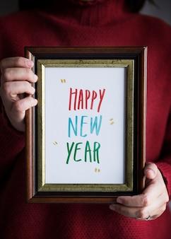 Fraza szczęśliwego nowego roku w ramce