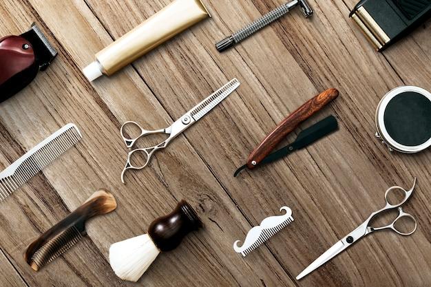 Fryzjer narzędzia tapety wzór drewniane tło koncepcja pracy i kariery
