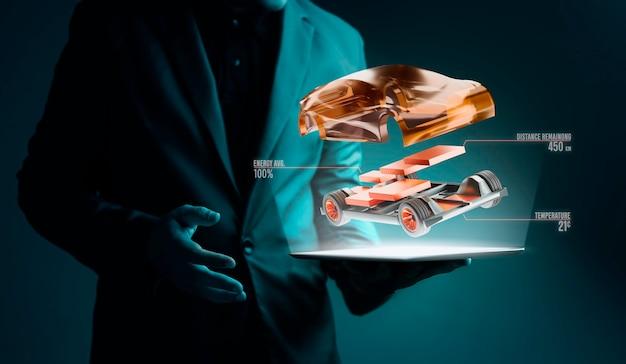 Futurystyczny biznesmen trzyma koncepcję przyszłości cyfrowego tabletu z hologramu
