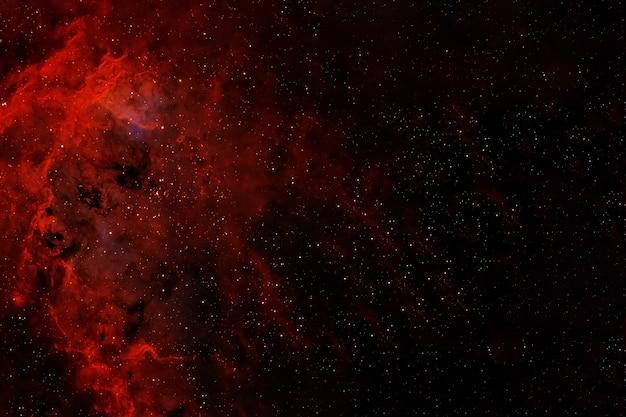 Galaktyka w czerwonych kolorach. elementy tego obrazu dostarczyła nasa. zdjęcie wysokiej jakości