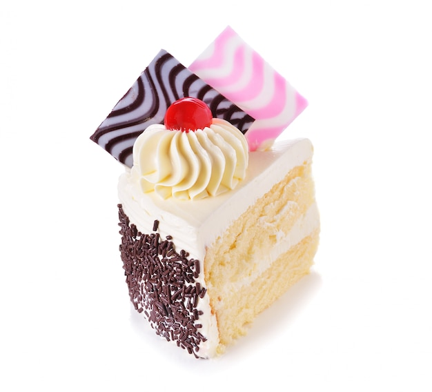Galanteryjny kawałek tort na białym tle