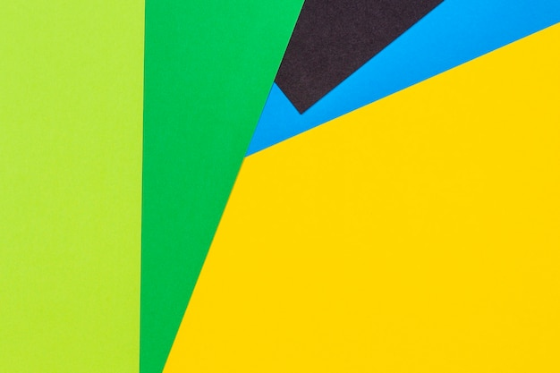 Geometryczne płaskie leżał żółty zielony niebieski i czarny kolor tła papieru