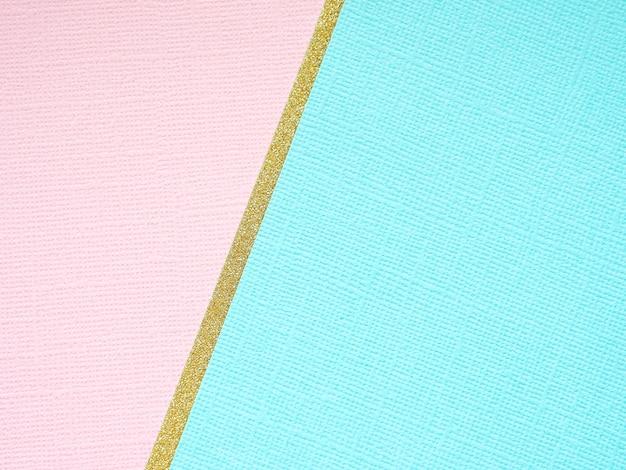 Geometryczne tło złoto, niebieski i różowy papier.