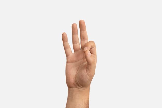 Gest języka migowego na białym tle