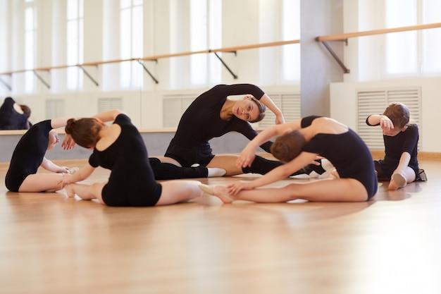Girls stretching in dance studio