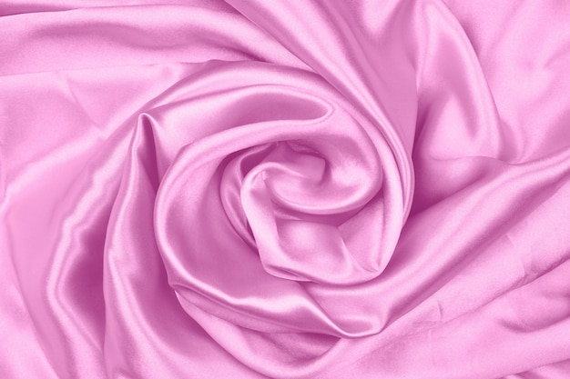 Gładka elegancka różowa jedwabiu lub satyny tekstury można użyć jako abstrakcyjne tło, tkaniny