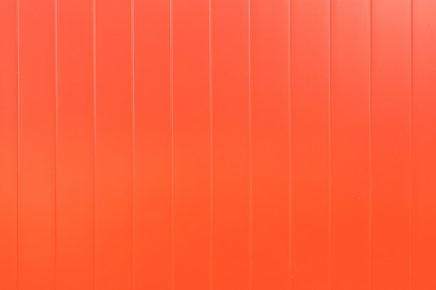 Gładka ściana z czerwonego metalu, okładka tekstury